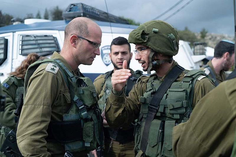 Commander of the Binyamin regional brigade Col. Sharon Assman at the scene of the attack at Assaf Junction.  IDF