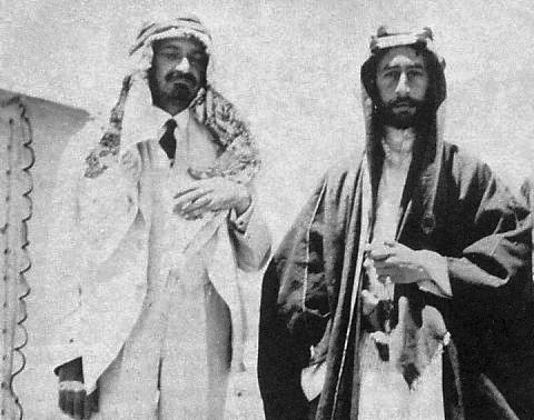 https://www.jewishpress.com/wp-content/uploads/Emir-Feisal-I-right-and-Chaim-Weizmann-wearing-an-Arab-dress-as-a-sign-of-friendship-in-Syria-1918..jpg