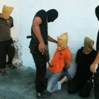 Masked Hamas members (dressed in black) prepare to execute local Palestinians who they claim spied for Israel, Aug. 22, 2014, in Gaza.