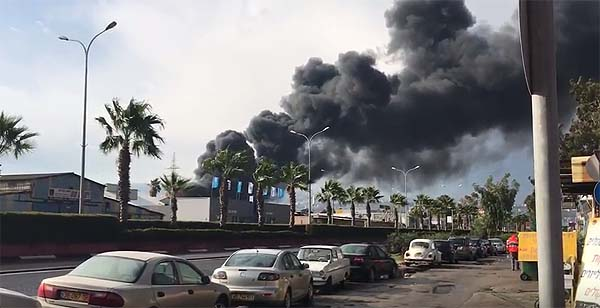 Heavy smoke over Haifa oil refineries