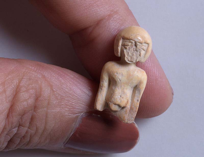 Ivory statue in the image of a woman. Photo credit: Clara Amit, Israel Antiquities Authority