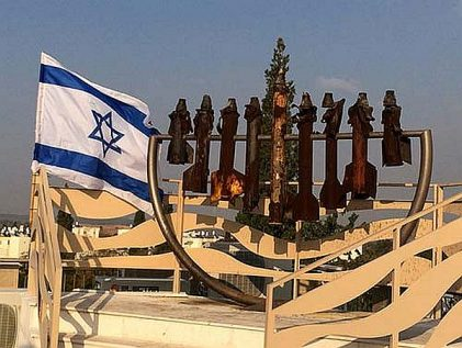 Hanukkah menorah at Yeshivat Sderot, created with the Qassam rockets fired from Gaza that exploded nearby