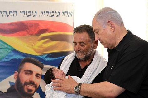 PM Netanyahu with the father and infant son of Police Officer Ha'il Stawi.