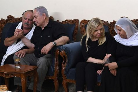 PM Netanyahu and his wife Sarah seated with the parents of Police Officer Kamil Sna'an