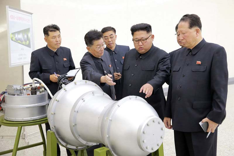 North Korea: Kim Jong Un watches 'H-Bomb' loaded on new missile