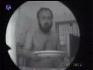 Marwan Barghouti caught eating on hidden camera during a hunger strike. August 17, 2004.