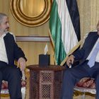 Last October, Palestinian Authority President Mahmoud Abbas met in Qatar with Khaled Mashaal and another Hamas leader, Ismail Haniyeh, as part of his rapprochement with the Islamist movement. Pictured above: Abbas (right) meets with Khaled Mashaal in Qatar on July 20, 2014, in a previous reconciliation attempt.