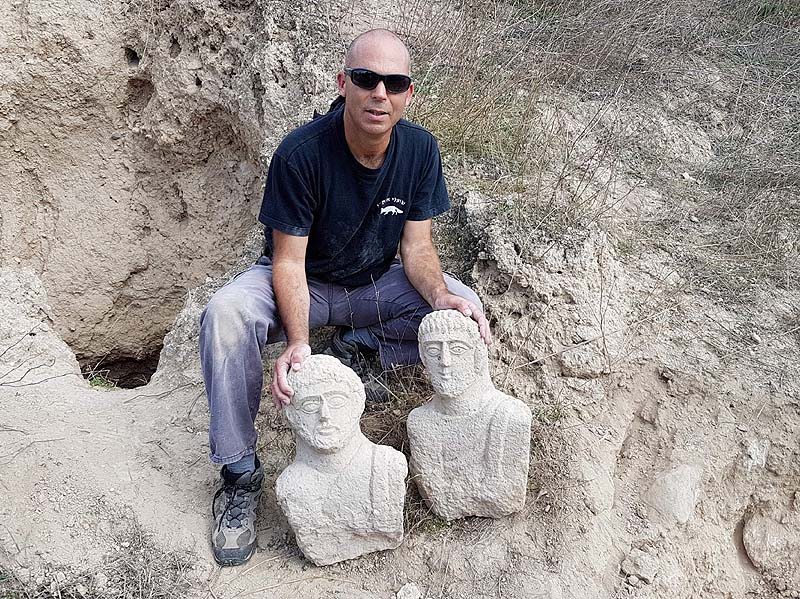 Hiking Woman Finds 1,700-Year-Old Stone Busts - image Nir-Distelfeld-Israel-Antiquities-Authority-Theft-Prevention-Unit-inspector-with-the-two-busts. on https://universegap.com