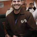 Maher Hashlamoun (center), was recently sentenced to two life terms in prison for murdering a Jewish woman and wounding others in an attack near Bethlehem. He is pictured above, smiling and laughing at his sentencing.