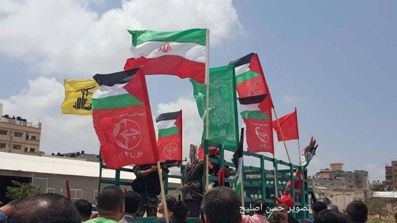 PLFP, Iran and Hezbollah flags at Trump 'hanging'