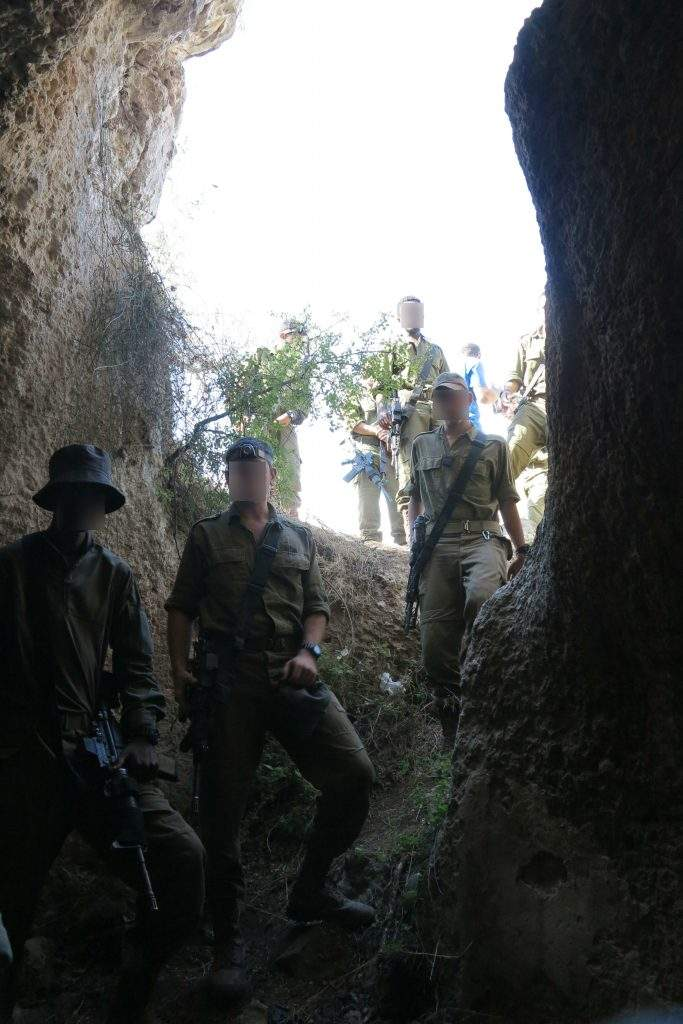 Paratroopers at the entrance to the water cavern / Photo credit: Courtesy Kfar Etzion Field School guides