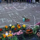People gathering, chalk drawings and flowers for the victims of the 2016 Brussels suicide bombing.