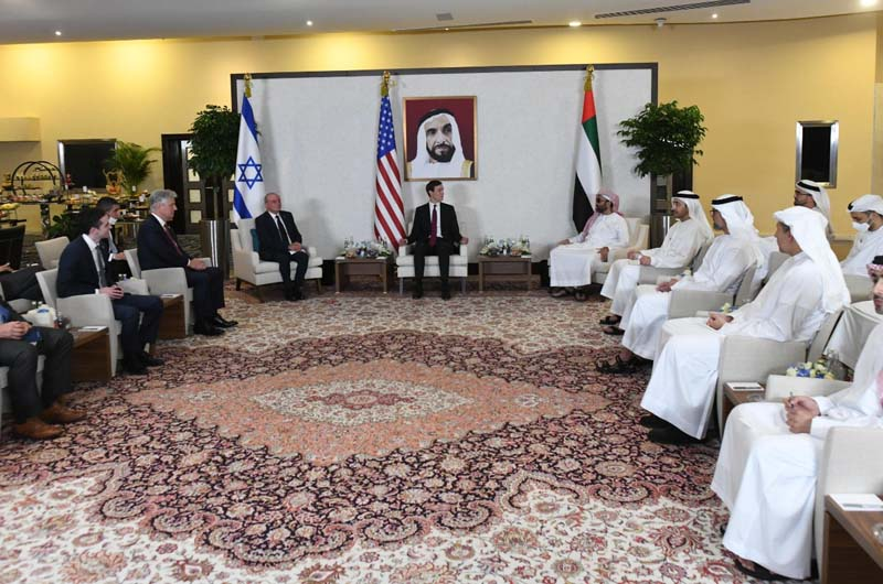 https://www.jewishpress.com/wp-content/uploads/President-Trumps-son-in-law-Jared-Kushner-and-head-of-the-Israeli-delegation-Meir-Ben-Shabbat-preside-over-the-first-meeting-between-UAE-and-Israeli-officials-in-Dubai-Aug.-31-2020.jpg
