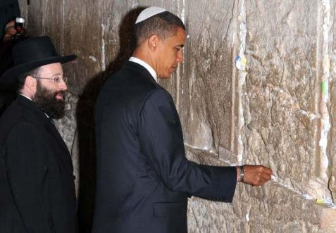 Presidential candidate Barack Obama dropping a kvitel in the 'occupied' Wall