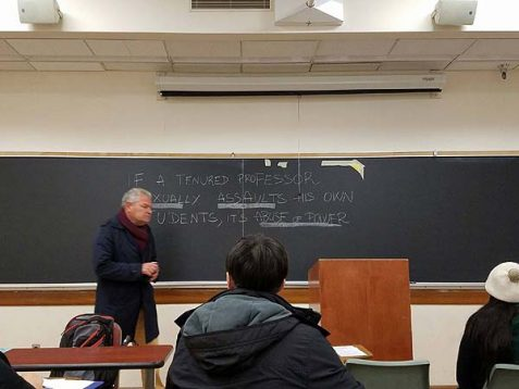 Professor Gabriel Piterberg teaching against a slogan attacking his presence in class.
