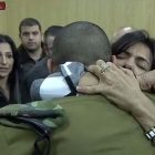 Sgt. Elor Azaria hugging his mother in court
