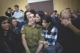 Sgt. Elor Azaria surrounded by family and friends.
