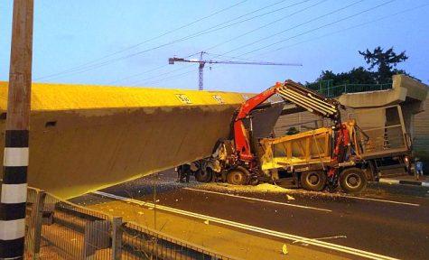Truck driver trapped beneath the collapsed Coca Cola Bridge in Bnei Brak