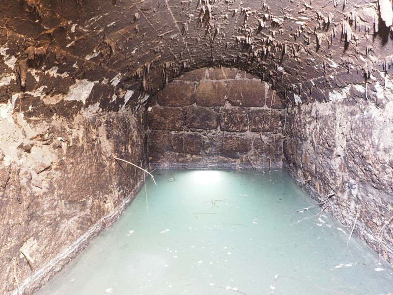 The water reservoir that researchers believe was used to store excess water from the well. / Photo credit: Assaf Peretz, IAA