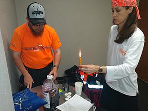 Amid helping evacuees, members of the IRC and United Hatzalah make Shabbat at Jack Brooks Regional Airport.
