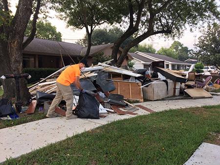 IRC team member Josh Cerf helps clean debris in Houston.