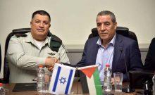 Maj. Gen. Yoav Mordechai and Hussein al-Sheikh