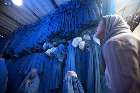 Woman burqa shopping