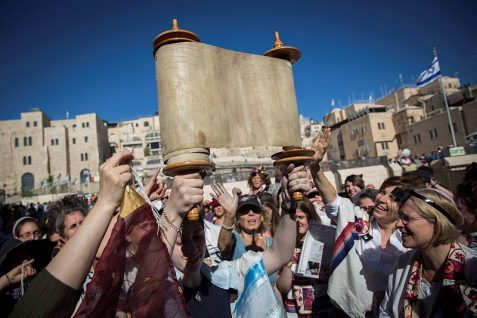 Members of the notorious Women of the Wall hold a Rosh Hodesh prayer with a Torah Scrol