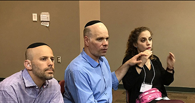 Mordy Weis from Israel listens to a lecture through his interpreter.