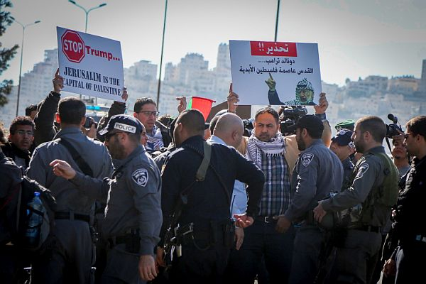 Israeli police detain a Palestinian Authority Arab protester on the day of the inauguration of US President Donald Trump. The protest took place near the city of Ma'ale Adumim, east of Jerusalem.
