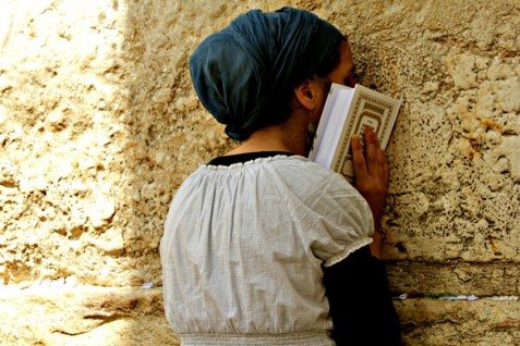 Jewish prayer at t\he Western Wall of the ancient courtyard of the destroyed Holy Temples.