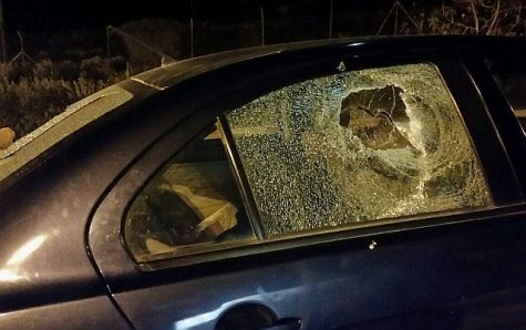 Side window smashed in Arab terror stoning attack.