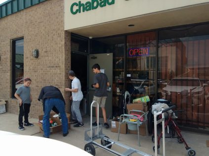 Unloading supplies for relief to Hurricane Harvey victims at Chabad Center in Houston, TX